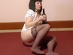 With a very hairy pussy brunette passionately fucks her ass bottle